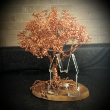 Enjoying making my copper wire trees door Irene Harms